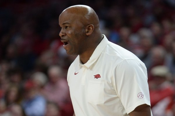 Arkansas associate head coach Chris Crutchfield speaks to his team Friday, Nov. 22, 2019, during the second half of play against South Dakota in Bud Walton Arena in Fayetteville. Visit nwadg.com/photos to see more photographs from the game.