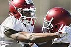 Arkansas receiver Mike Woods (facing) is shown during practice Saturday, March 3, 2018, in Fayetteville.