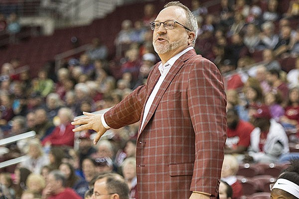 Arkansas women's basketball coach Mike Neighbors is shown during a game against Arkansas-Little Rock on Saturday, Dec. 21, 2019, at Simmons Bank Arena in North Little Rock.