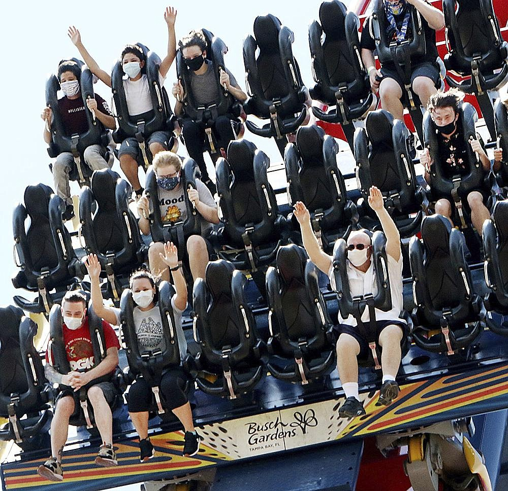 Patrons of Busch Gardens in Tampa Bay, Fla., enjoy the 200-foot dive on the SheiKra roller coaster Thursday. More photos at arkansasonline.com/612florida/. (AP/Tampa Bay Times/Douglas R. Clifford)