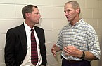 Arkansas baseball coach Dave Van Horn (left) speaks with former baseball coach Norm DeBriyn on Friday, June 21, 2002, at Bud Walton Arena in Fayetteville. Van Horn, a former Arkansas player and assistant coach, was introduced as the replacement for retiring DeBriyn during a news conference.