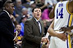 LSU assistant coach Greg Heiar, center, coaches from the sidelines during the second half of the first round men's college basketball game against Yale in the NCAA Tournament, in Jacksonville, Fla. Thursday, March 21, 2019. (AP Photo/Stephen B. Morton)