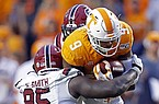 Tennessee running back Tim Jordan (9) runs for yardage as he's hit by South Carolina defensive lineman Kobe Smith (95) in the second half of an NCAA college football game Saturday, Oct. 26, 2019, in Knoxville, Tenn. (AP Photo/Wade Payne)