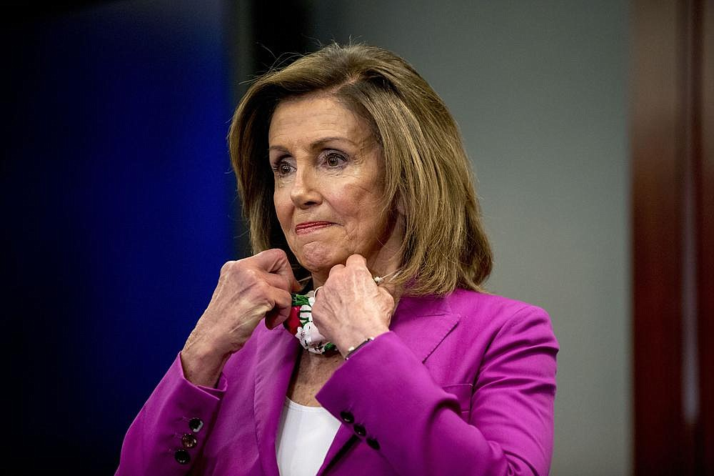 """House Speaker Nancy Pelosi, shown Tuesday, on Wednesday called the Senate's police legislation """"inadequate"""" but said House Democrats hope to help craft a measure that helps end """"the epidemic of racial injustice and police brutality in America."""" (AP/Andrew Harnik)"""