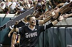 Mississippi State's Jake Mangum reaches out to fans as they celebrate winning Game 2 against Stanford at the NCAA college baseball super regional tournament in Starkville, Miss., Sunday, June 9, 2019. Mississippi State won 8-1, and advanced to the College World Series. (AP Photo/Rogelio V. Solis)