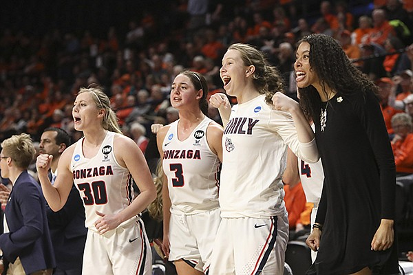 The Gonzaga bench, including, from left to right, Chandler Smith (30), Jenn Wirth (3), Gillian Barfield and Kylee Griffin, celebrate a call in their favor during the second half of a first-round game of the NCAA women's college basketball tournament against Little Rock in Corvallis, Ore., Saturday, March 23, 2019. (AP Photo/Amanda Loman)