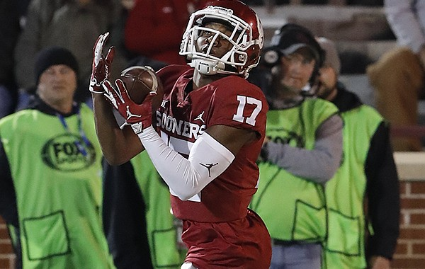 Oklahoma wide receiver Jaquayln Crawford (17) makes a catch during warm ups before the start of an NCAA college football game against Kansas in Norman, Okla., Saturday, Nov. 17, 2018. (AP Photo/Alonzo Adams)