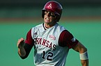 Arkansas' Craig Gentry runs toward home plate to score against the University of Texas Saturday night in the second round of the NCAA Baseball Austin Regional. Gentry was a four-sport standout at Fort Smith Christian from 2000 to 2002 and was a member of five state championship teams in three different sports in high school.