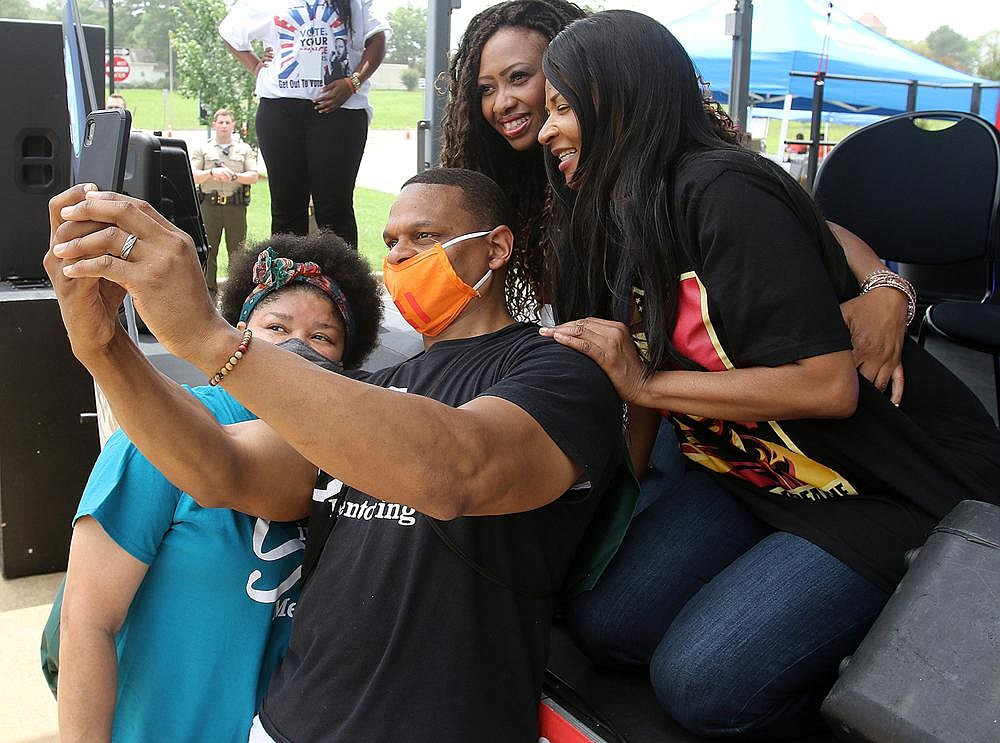 Katrina and Walter Sims (foreground) of North Little Rock pose for a selfie Saturday with George Floyd's cousin Paris Stevens (left) and his aunt Angela Harrelson after Saturday's event in Little Rock. More photos at www.arkansasonline.com/628floyd/.