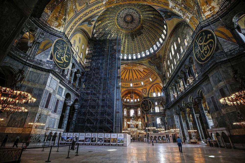 People visit the main chamber of Hagia Sophia. Turkey has been allowing readings inside, and Turkish President Recep Tayyip Erdogan has recited prayers there. (AP/Emrah Gurel)