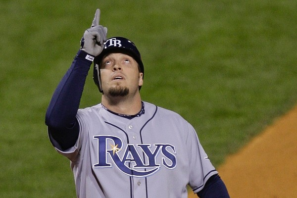 Tampa Bay Rays' Eric Hinske points up to the sky as he crosses home after hitting a home run during the fifth inning of Game 4 of the baseball World Series against the Philadelphia Phillies in Philadelphia, Sunday, Oct. 26, 2008. (AP Photo/Julie Jacobson)