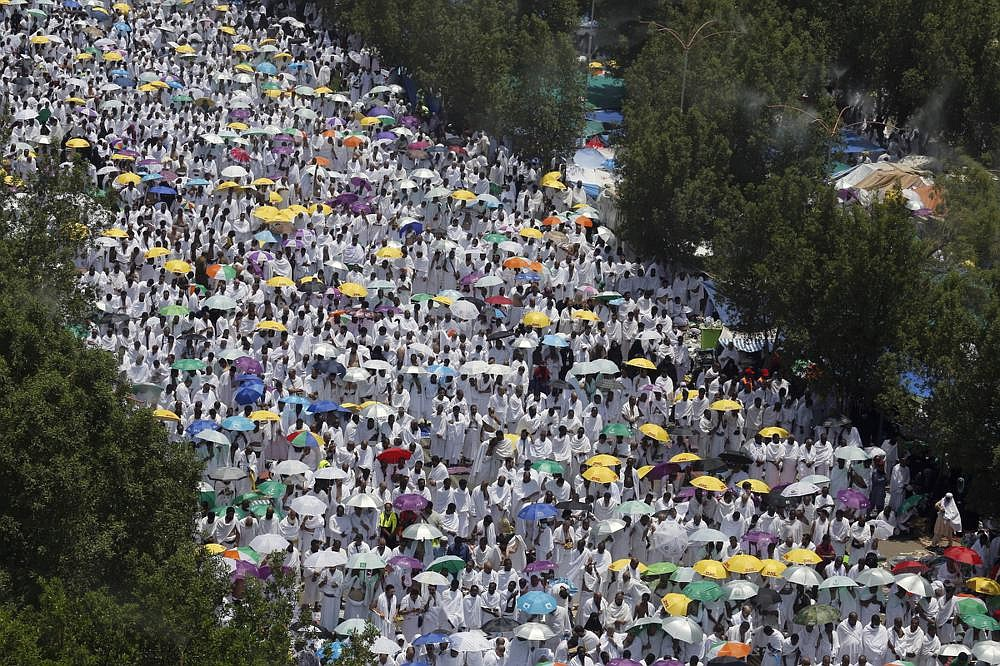 Hundreds of thousands of Muslim pilgrims pray outside Namira  Mosque  in Arafat  during  the  annual  hajj  pilgrimage  in August,  near the holy city of Mecca, Saudi Arabia. The kingdom's recent  announcement that only around 1,000 people would be allowed  to perform the pilgrimage dealt a blow to travel agencies specializing in facilitating trips to Mecca and pilgrims alike.