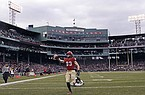 In this Nov. 17, 2018, file photo, Harvard wide receiver Jack Cook (83) raises the ball after crossing the goal line for a touchdown against Yale during the second half of an NCAA college football game at Fenway Park in Boston. The Ivy League has canceled all fall sports because of the coronavirus pandemic. (AP Photo/Charles Krupa, File)