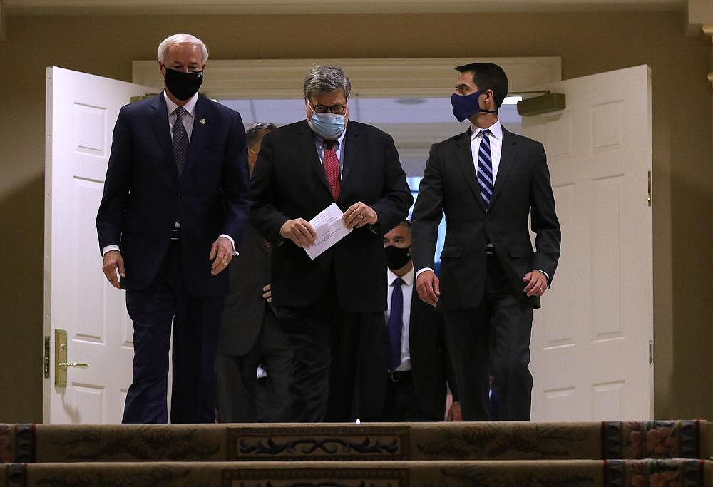 Gov. Asa Hutchinson (from left), U.S. Attorney General William Barr and U.S. Sen. Tom Cotton, R-Ark., enter the ballroom at the Governor's Mansion on Thursday for a lunch gathering. (Arkansas Democrat-Gazette/Thomas Metthe)