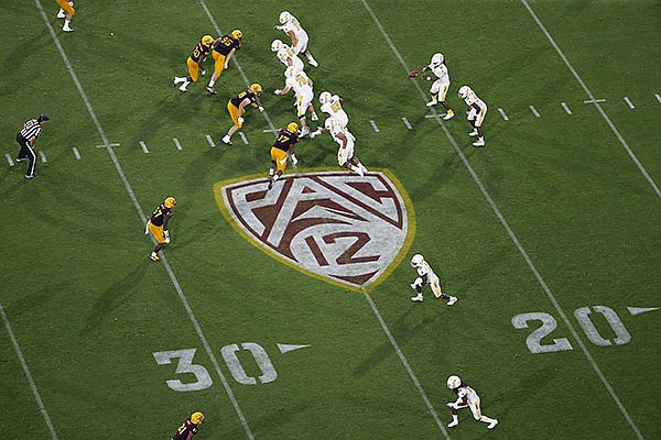 PAC-12 logo during the second half of an NCAA college football game between Arizona State and Kent State, Thursday, Aug. 29, 2019, in Tempe, Ariz. (AP Photo/Ralph Freso)
