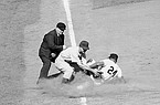 Chicago Cubs third baseman Randy Jackson takes a throw as New York Giants outfielder Willie Mays (24) slides into third base during a game June 27, 1954, at the Polo Grounds in New York. (AP Photo)