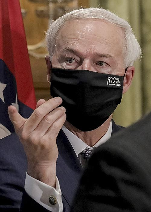 """The rise in coronavirus cases """"is a reminder of the work we have to do,"""" Gov. Asa Hutchinson said Thursday as he announced the delay in the start of school. More photos at arkansasonline.com/710gov/. (Arkansas Democrat-Gazette/John Sykes Jr.)"""