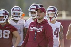 NWA Democrat-Gazette/BEN GOFF @NWABENGOFF Justin Stepp, Arkansas wide receivers coach, runs a drill Thursday, March 1, 2018, during Arkansas spring football practice at the Fred W. Smith Football Center in Fayetteville.