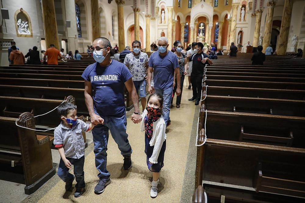 Parishioners leave at the end of a Spanish-language Mass at Saint Bartholomew Roman Catholic Church in the Queens borough of New York.