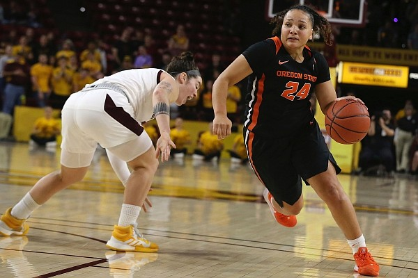 Oregon State's Destiny Slocum (24) drives to the basket after faking out Arizona State's Robbi Ryan during the first half of an NCAA college basketball game Sunday, Jan. 12, 2020, in Tempe, Ariz.