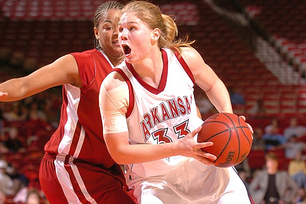 Arkansas forward Sarah Pfeifer (33) makes a move around Alabama guard/forward Navonda Moore during the Lady Razorbacks' 83-68 win Feb. 10, 2005, at Bud Walton Arena in Fayetteville.