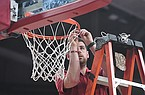 Arkansas basketball video coordinator Riley Hall fixes a net during a game against LSU on Wednesday, March 4, 2020, in Fayetteville.