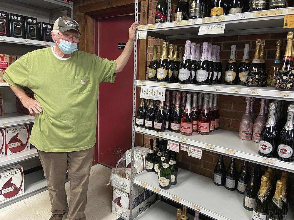 Ferdie Moore, owner of Ferdie's Discount Wine and Liquor in Meridian, Miss., displays his dwindling stock Wednesday and describes shipment delays because of statewide demand for alcohol. The Mississippi Alcoholic Beverage Control agency is reporting record liquor sales and a struggle by suppliers to maintain inventory nationwide.