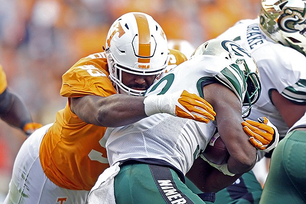 Tennessee defensive lineman Emmit Gooden (93) tackles Charlotte running back Benny LeMay (32) in the first half of an NCAA college football game Saturday, Nov. 3, 2018, in Knoxville, Tenn. (AP Photo/Wade Payne)