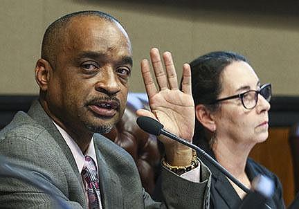 Ward 2 Director Ken Richardson (left) is shown in this file photo. (Arkansas Democrat-Gazette file photo)