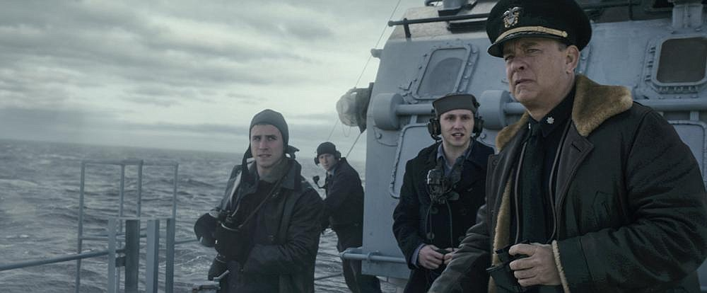 """Captain Ernest Krause (Tom Hanks) and members of his crew watch for German U-boats in """"Greyhound,"""" which is streaming on Apple TV +."""