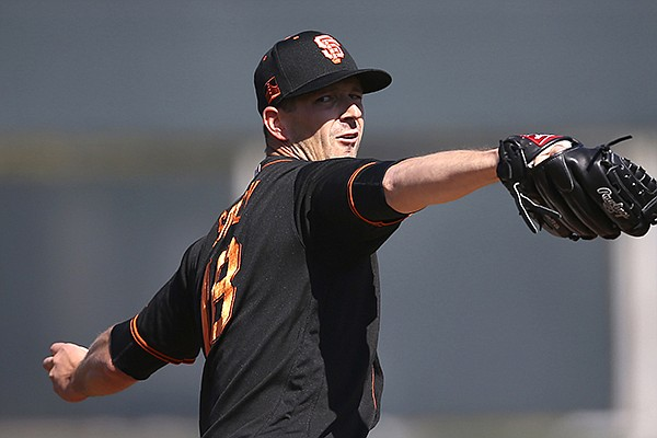 San Francisco Giants starting pitcher Drew Smyly warms up during the second inning of a spring training baseball game against the Arizona Diamondbacks Monday, Feb. 24, 2020, in Scottsdale, Ariz. (AP Photo/Ross D. Franklin)