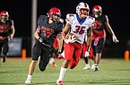 Little Rock Parkview tight end Erin Outley (36) runs away from a Maumelle defender during a game Friday, Oct. 4, 2019, at Hornet Stadium in Maumelle.