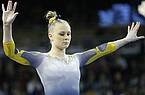 Michigan gymnast Maggie O'Hara during an NCAA gymnastics meet on Sunday, Feb. 9, 2020 in Ann Arbor, Mich. (AP Photo/Rick Osentoski)