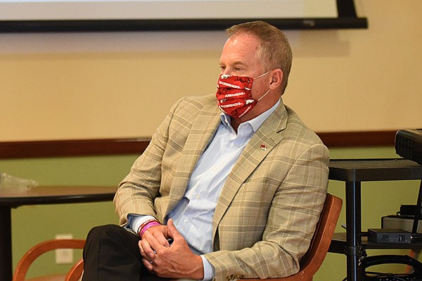 Arkansas athletics director Hunter Yurachek listens to Gov. Asa Hutchinson speak Wednesday, July 22, 2020, during his daily covid-19 briefing at the Center for Exercise on the campus of Washington Regional Medical Center in Fayetteville.