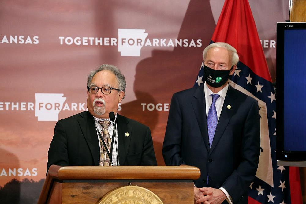 """Interim Health Secretary Jose Romero and Gov. Asa Hutchinson discuss testing during Thursday's daily briefing. Hutchinson says the state """"is doing well in testing,"""" and he and Romero say testing is being expanded. (Arkansas Democrat-Gazette/Thomas Metthe)"""