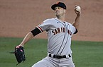 San Francisco Giants starting pitcher Drew Smyly throws to a Los Angeles Dodgers batter during the first inning of a baseball game, Sunday, July 26, 2020, in Los Angeles. (AP Photo/Jae C. Hong)