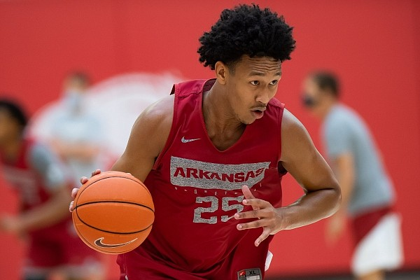 Arkansas freshman forward Jaylin Williams dribbles the ball up the floor during a team practice in the program's Basketball Performance Center. A standout at Fort Smith Northside, Williams is part of the Razorbacks' 2020 recruiting class that is ranked No. 5 by ESPN.