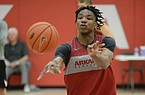 Arkansas guard JD Notae passes to the wing Thursday, Sept. 26, 2019, during practice in the Eddie Sutton Gymnasium inside the Basketball Performance Center in Fayetteville. Visit nwadg.com/photos to see more photographs from the practice.