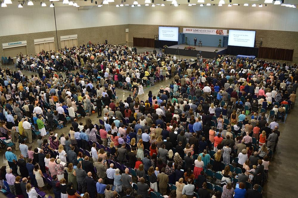 Jehovah's Witnesses gather at one of the faith's annual conventions last year at the Fort Smith Convention Center in Fort Smith. The global coronavirus pandemic meant the program, some aspects of which are planned several years in advance, had to make an abrupt shift to an online platform, and be translated into more than 500 languages in a matter of weeks. (Special to the Democrat-Gazette)