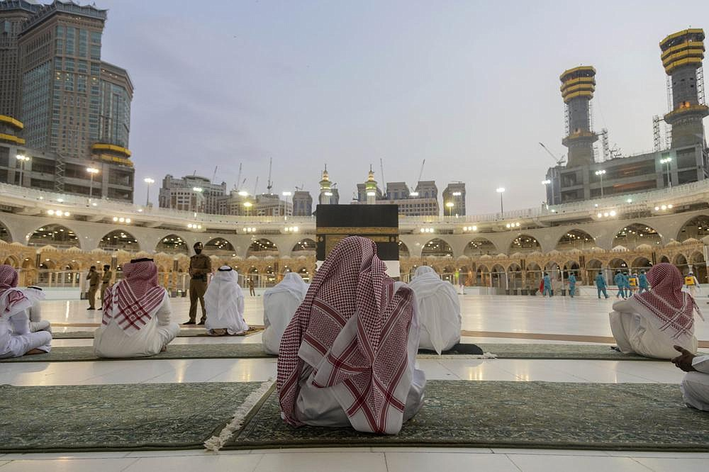 Pilgrims pray around the Kaaba, the square structure in the Great Mosque, toward which believers turn when praying, in Mecca, Saudi Arabia, on Sunday.