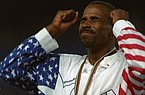 USA's Mike Conley of Fayetteville, Ark. reacts after receiving his gold medal for the men's triple jump event at the Summer Olympic Games in Barcelona Monday, August 3, 1992. (AP Photo/Deither Endlicher)