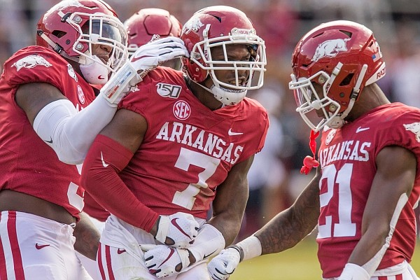Joe Foucha, Arkansas free safety, and Montaric Brown, Arkansas cornerback, celebrate after Foucha made a stop to force an Auburn turnover in the first quarter on Saturday, Oct. 19, 2019, at Reynolds Razorback Stadium in Fayetteville.