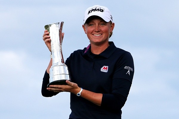 Stacy Lewis poses with trophy after winning Women's British Open golf championship on the Old Course at St. Andrews, Scotland on Sunday.