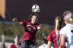 Arkansas forward Taylor Malham heads a ball during a game against Georgia on Sunday, Oct. 27, 2019, in Fayetteville.