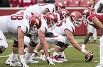 Arkansas linemen line up for a snap during a scrimmage Saturday, April 6, 2019, in Fayetteville.
