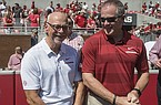 University of Arkansas chancellor Joseph Steinmetz (left) and athletics director Hunter Yurachek are shown during a game between the Razorbacks and Eastern Illinois on Saturday, Sept. 1, 2018, in Fayetteville.