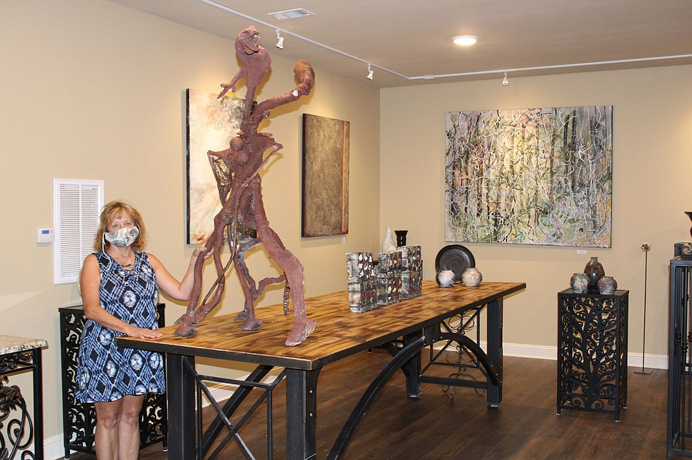 Laura Blue Waters shows artwork in her new location at 430 Valley St., the gallery's third location. - Photo by Tanner Newton of The Sentinel-Record