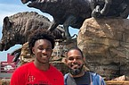 Arkansas basketball commit Chance Moore and his father, John, during their recent visit to Fayetteville.