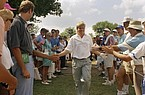 Former Arkansas Razorback John Daly is greeted by spectators during the final round of the 73rd PGA Championship in 1991. Daly went from being the ninth alternate to champion as he watched his popularity soar over the course of the weekend.