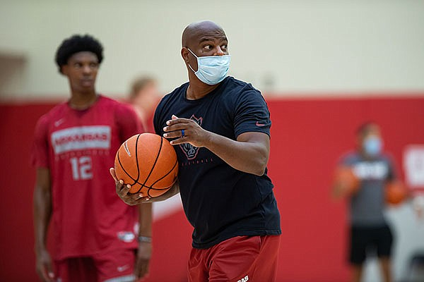 Arkansas assistant basketball coach David Patrick is shown during a July 2020 workout in Fayetteville.